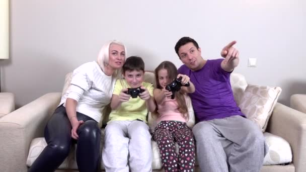 Happy family playing a video game, slowmotion