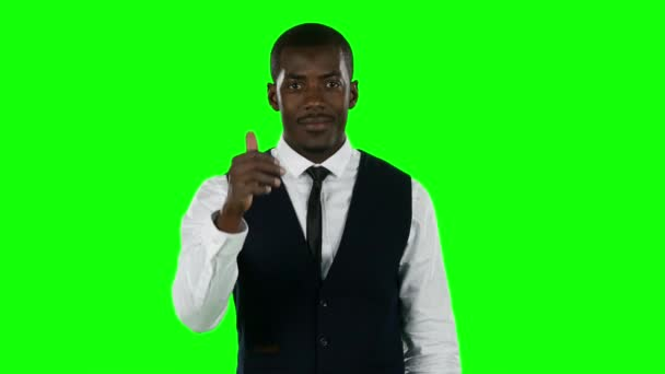 Businessman showing a thumbs. Green screen