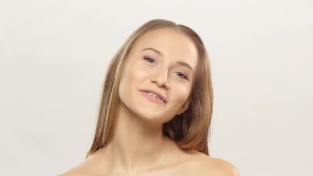 Young girl shows her smile braces. White