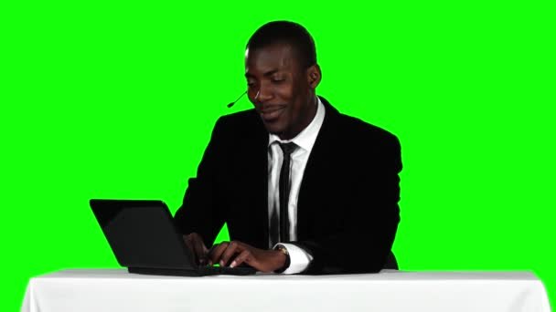 Call center operator accepts the order online and smiling. Green screen