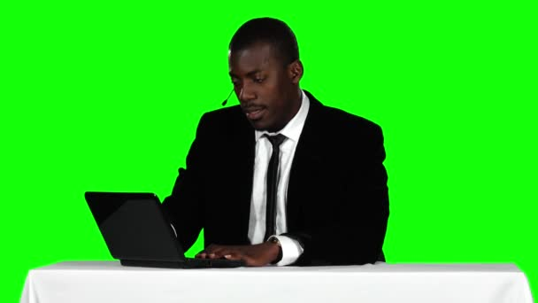 Call center operator accepts the order online. Green screen
