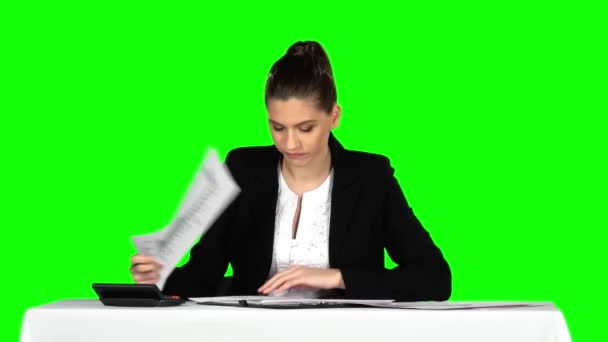 Businesswoman overwhelmed by too much paperwork in office. Green screen
