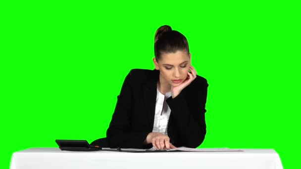 Business woman working from office with documents. Green screen