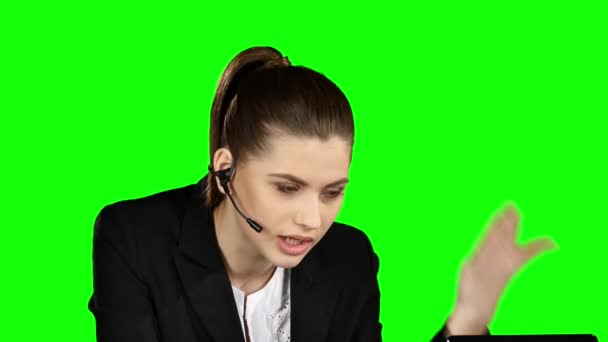 Angry female helpdesk consultant in the office. Green screen