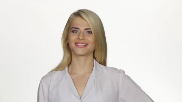 Female doctor smiling to camera. White