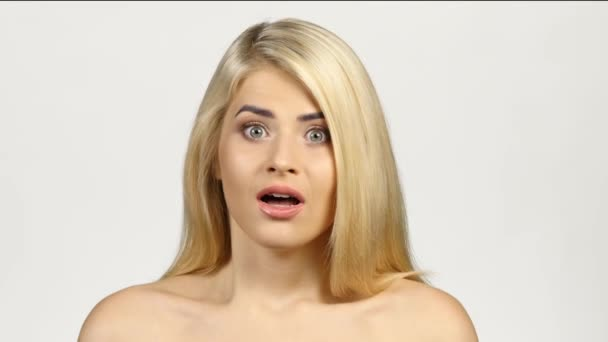 Shocked blonde woman. White