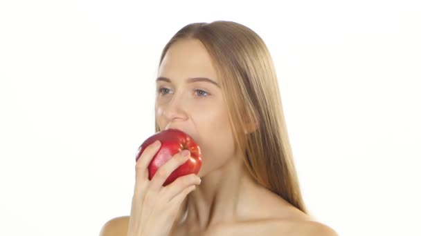 Blonde girl with braces eating a big red apple. White. Closeup
