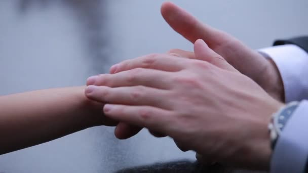 Female hand in a mans hand outdoors, close-up