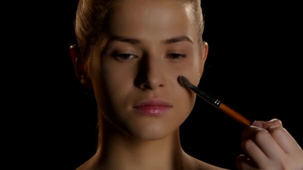 Makeup. Cosmetics. Makeup artist at work