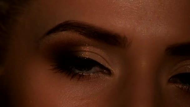 Eyes of young woman with natural makeup. Black. Closeup