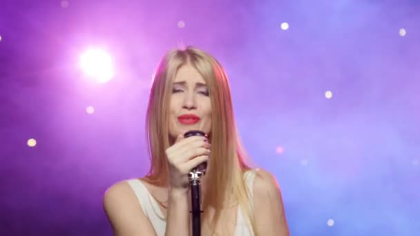 Blonde girl singing into a retro microphone, strobe lighting effect
