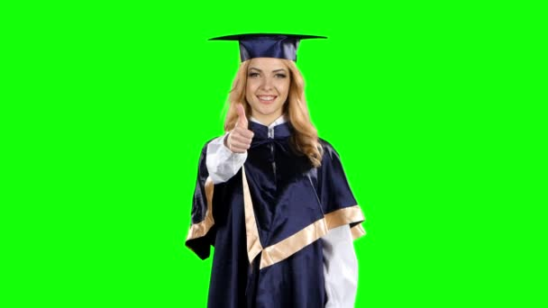 Graduate with a thumbs up sign. Green screen