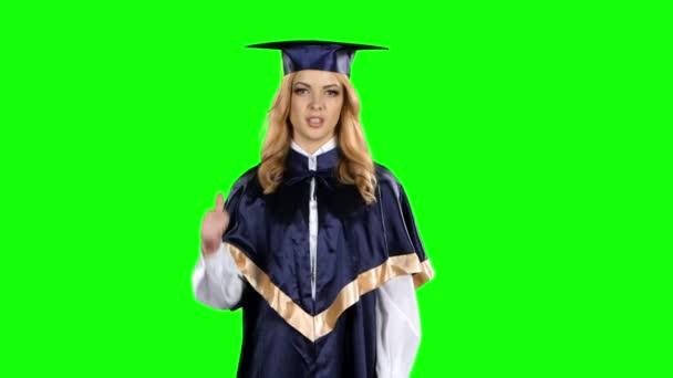 Diplomás a hüvelykujját lefelé. Zöld képernyő