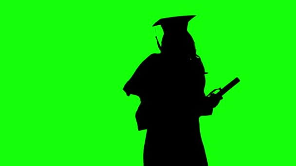 Graduate of dancing after the ceremony of awarding the diploma. Silhouette. Green screen