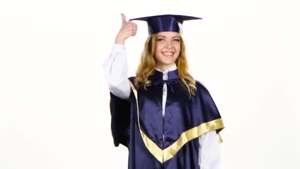 Graduate shows thumb up. White