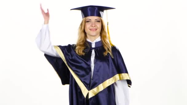 Graduate tossing a cap in the air. White