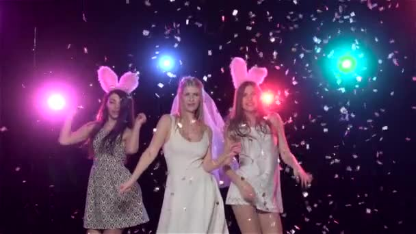 Girls dancing at bachelorette party against stroboscope lamps, slow motion