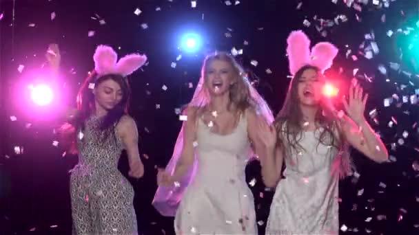 Girls dancing at bachelorette party against stroboscope lamps. Slow motion