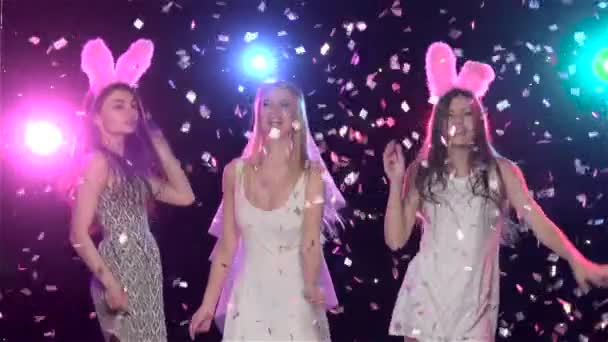 Girls at bachelorette party dancing and kiss bride. Slow motion