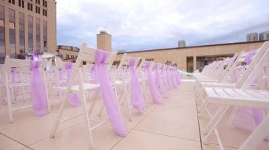 White wooden chairs. Wedding aisle decor. Outdoors wedding ceremony ...