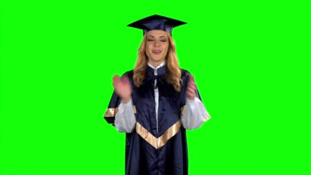 Absolventa dívka. Překvapení. Zelená obrazovka. Zpomalený pohyb