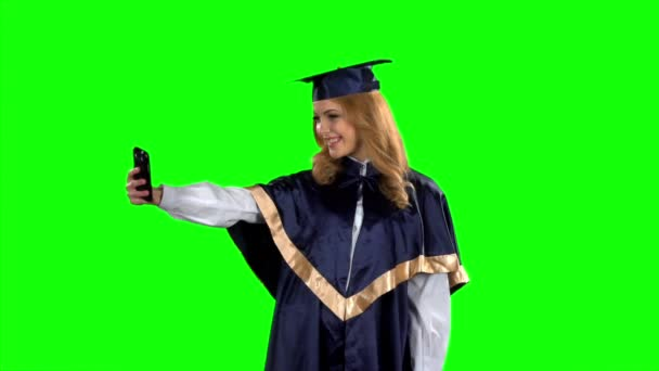 Graduate taking picture with smartphone. Green screen. Slow motion