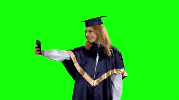 Diplomás bevétel-kép smartphone. Zöld képernyő. Lassú mozgás