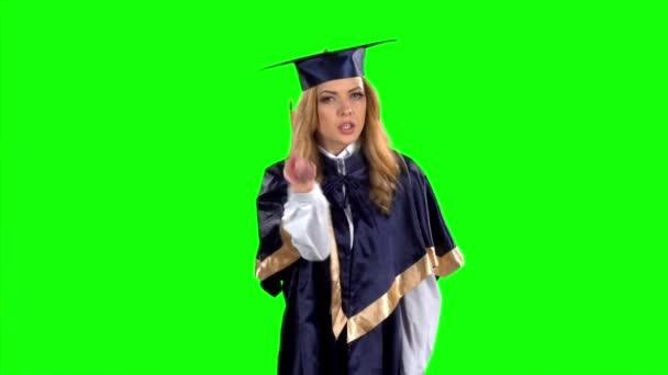 Student. Absolvent. Zelená obrazovka. Zpomaleně