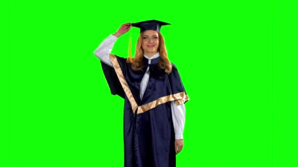 Graduate throws his cap in the air. Green screen. Slow motion