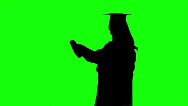 Graduate with a diploma. Graduation at the university. Alpha channel. Silhoutte