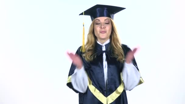 Surprised and happy graduate. White. Slow motion