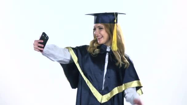 Graduate makes selfie photo. White. Slow motion
