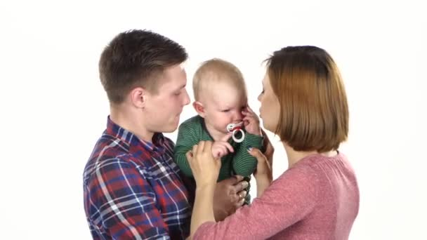 Parents with their cute baby son. White