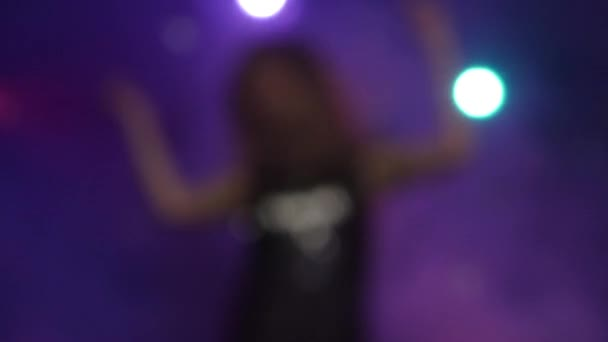 Out of focus background with blurry and dancing girl