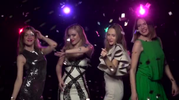 Dancing girlfriends send blowing kisses at the party. Slow motion