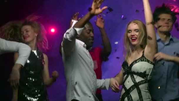 Dancing girl with African American man at party. Slow motion
