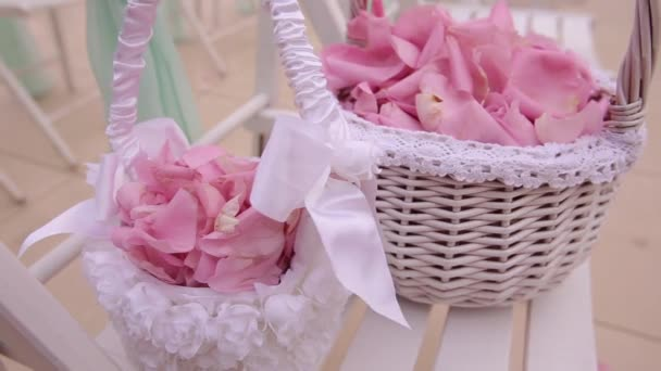 Wedding decoration. Colorful petals of roses in baskets. Close up