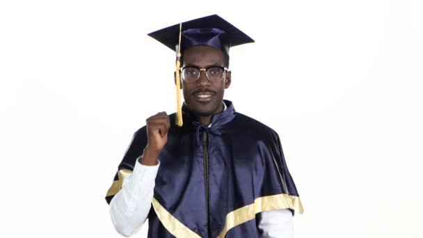 Black man in dressed for graduation. White. Close up