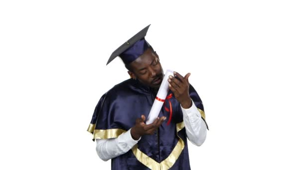 Student kissing diploma. White
