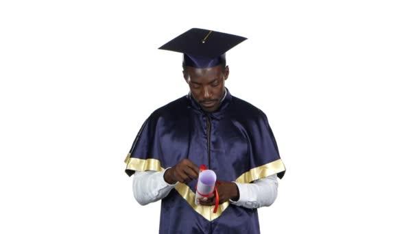 Graduate looks into the diploma. White