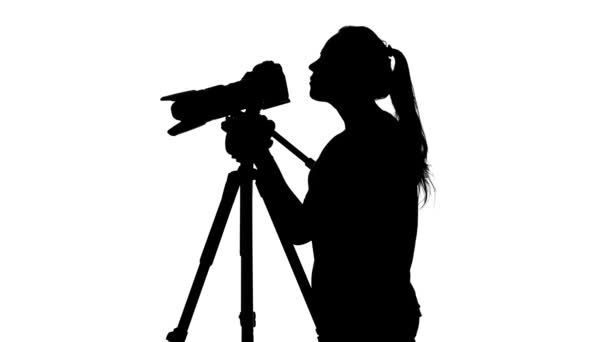 Fotograf utrácí video. Bílé. Silueta