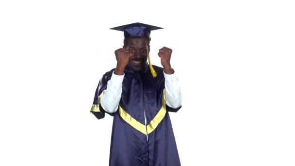 Graduate smiling and dancing. White. Slow motion