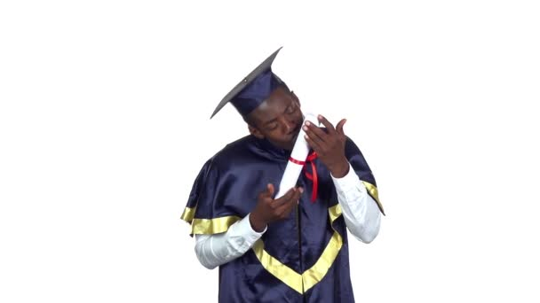 Graduate kissing diploma. Slow motion. White