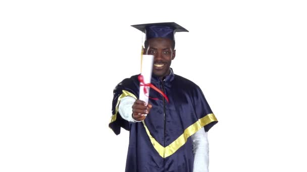 Student with a diploma wrapped in a ribbon. Slow motion. White