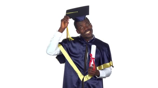 Student with a diploma and the academic hat. Slow motion. White