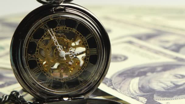 Watch skeleton on a background of money. Close up