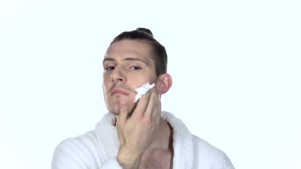 Man applying shaving foam. White background. Slow motion