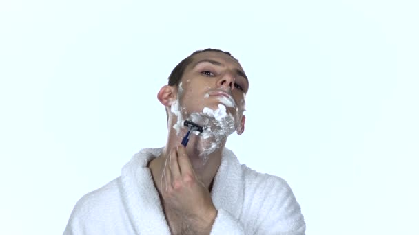 Man shaving his facial with disposable manual razor. Slow motion