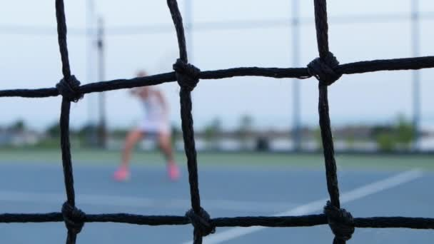 Tennis net in front. Tennis. Outdoor courts