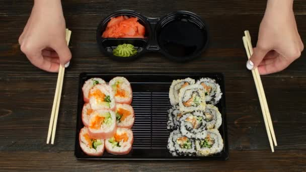 Rolls ready for catering. Sushi in plastic dishes. Close up
